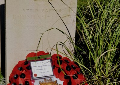 The headstone of 57710 Sapper Burchall Dinham-Peren at Charleroi Communal Cemetery.